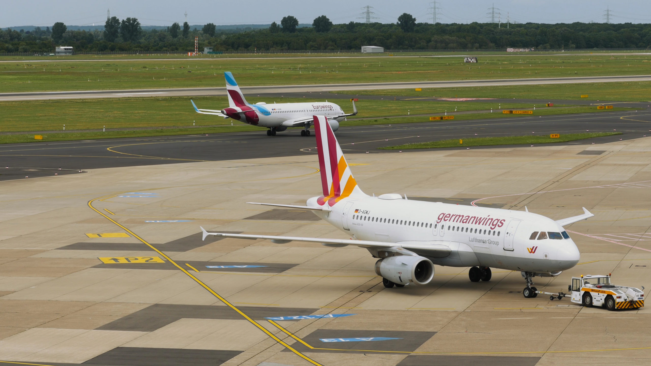 Airbus A320 D-AGWJ of Germanwings is towing by vehicle on airfield before departure
